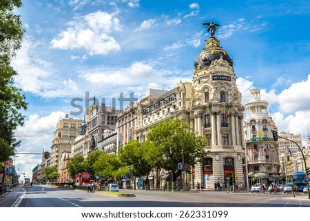 MADRID, SPAIN - JULY 11: Metropolis hotel in Madrid in a beautiful summer day on July 11, 2014 in Madrid, Spain - stock photo