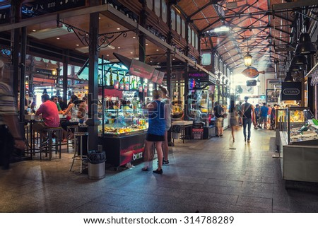 MADRID, SPAIN - JULY 22, 2015: People eating at Mercado San Miguel, which is one of the most popular places in the city. Different food stalls, drinks, seafood - stock photo