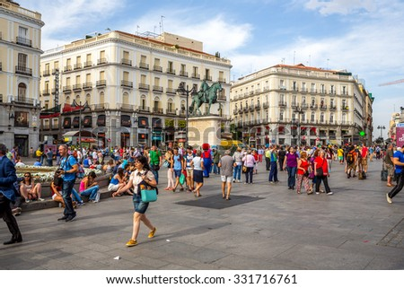 MADRID, SPAIN - JUN 6: Puerta del Sol, Madrid, one of the famous landmarks of the capital and the centre (Km0) of the radial network of Spanish roads on June 6, 2014 in Madrid, Spain - stock photo