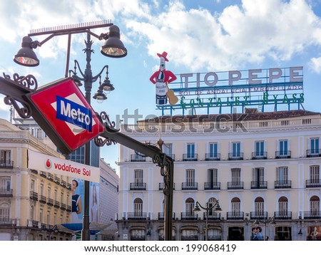 MADRID, SPAIN - JUN 17: The Neon iconic Tio Pepe is replaced in the Puerta del Sol in Madrid, June 17, 2014 in Madrid, Spain. This billboard is one of the most famous symbols of the city