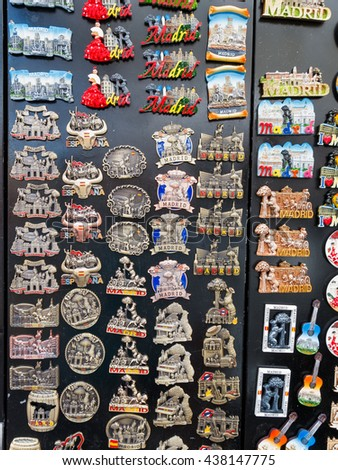 MADRID, SPAIN - JUN 05, 2016: Typical souvenirs of the city of Madrid for sale at a flea market, Spain, Jun 05, 2016 in Madrid, Spain