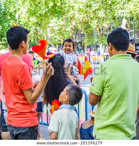 MADRID, SPAIN - JUN 19, 2014: Unidentified Spanish people in the centre of Madrid on a case the celebration on a day of the inauguration of the New King of Spain Felipe IV