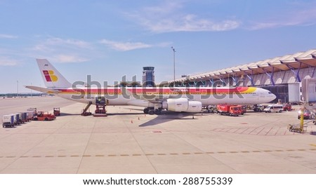 MADRID, SPAIN -5 JUNE 2015- Planes from the Spanish airline Iberia (IB) are lined up at the Adolfo Suarez Madrid Barajas Airport (MAD).