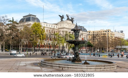 MADRID, SPAIN - MAR 23, 2014: Fountain of the Paseo del Prado, Madrid, Spain. Paseo del Prado is one of the main boulevards in Madrid