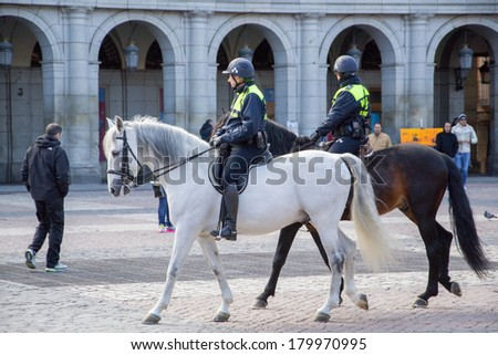 MADRID, SPAIN - MAR 4, 2014: Horse police on the Plaza Mayor, Madrid, Spain. It's the Spanish Property of Cultural Interest
