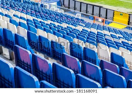MADRID, SPAIN - MAR 11, 2014: Seats of the Santiago Bernabeu stadium. Santiago Bernabeu is a home arena for the Real Madrid Club de Futbol - stock photo