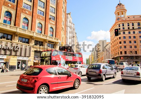 MADRID, SPAIN - MAR 4, 2014: Traffic on the Gran Via street, Madrid, Spain. Gran via is known as the the street that never sleeps or as Spanish Brodway