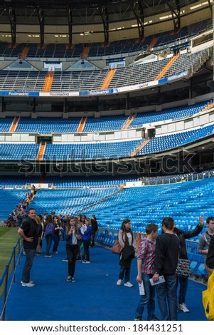 MADRID, SPAIN - MAR 11, 2014: Unidentified tourists near the bench of Real Madrid at the Santiago Bernabeu stadium. Santiago Bernabeu is a home arena for the Real Madrid Club de Futbol - stock photo