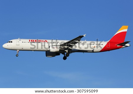 MADRID, SPAIN - MARCH 5:  An Iberia Airbus A321 approaching on March 5, 2015 in Madrid. Iberia is the flag carrier airline of Spain with its headquarters in Madrid. - stock photo