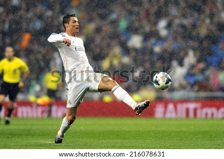 MADRID, SPAIN - March 29th, 2013 : Portuguese CRISTIANO RONALDO of REAL MADRID in action under the rain during La Liga match at Santiago Bernabeu Stadium.  - stock photo