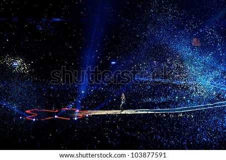 MADRID, SPAIN - MAY 20: Coldplay band performs at Vicente Calderon stadium on May 20, 2012 in Madrid, Spain. Mylo Xyloto tour. - stock photo