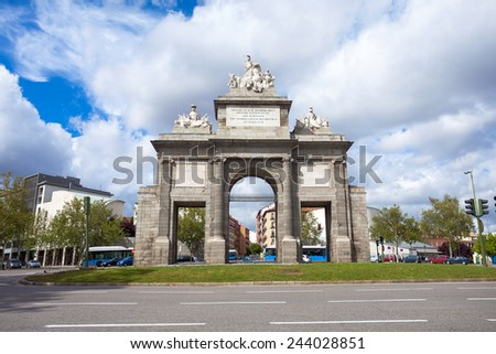 Madrid, Spain - May 5, 2012: Gate of Toledo (Puerta de Toledo) on a sunny spring day in Madrid, Spain - stock photo