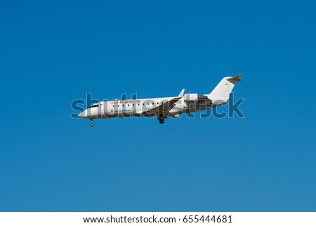 Madrid, Spain - May 22, 2017: Iberia Bombardier CRJ 200 ER  is landing in Madrid Barajas airport on May 22, 2017. Iberia is the  flag carrier and the largest spanish airways company.