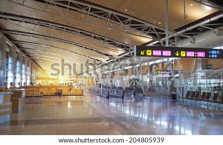 MADRID, SPAIN - MAY 28, 2014: Interior of Madrid airport, departure waiting aria - stock photo