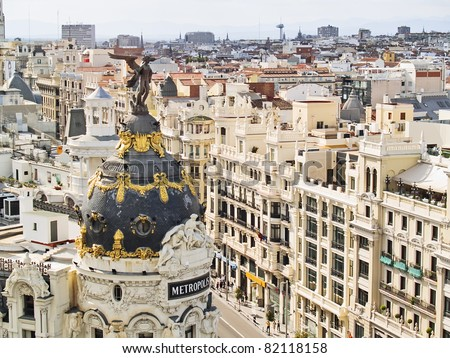 MADRID, SPAIN - MAY 20: Metropolis building in Madrid on 20, 2011 in Madrid, Spain. This famous building was constructed in 1911 by French architects Jules and Raymond Fevrier in new Renaissance style - stock photo