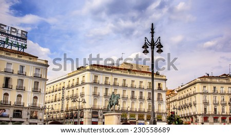 MADRID, SPAIN - MAY 8, 2014 Puerta del Sol Gate of the Sun Famous Square King Carlos III Equestrian Statue in Madrid Spain King of Spain in the 1700s. Statue replica created 1700s by Juan Mena - stock photo