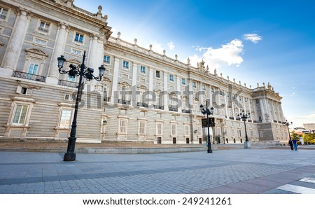 Madrid, Spain - May 6, 2012: Royal palace (Palacio Real de Madrid) with tourists on spring day in Madrid, Spain - stock photo