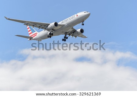 MADRID, SPAIN - MAY 23th 2015: Aircraft -Airbus A330-243-, of -American Airlines- airline, landing on Madrid-Barajas -Adolfo Suarez- airport, on May 23th 2015. - stock photo