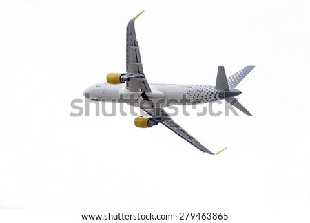 MADRID, SPAIN - MAY 3th 2015: Aircraft -Airbus A320-, of -Vueling- airline, is taking off from Madrid-Barajas -Adolfo Suarez- airport, on May 3th 2015. - stock photo