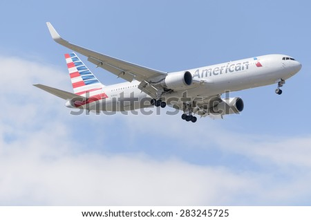 MADRID, SPAIN - MAY 23th 2015: Aircraft -Boeing 767-323-, of -American Airlines- airline, landing on Madrid-Barajas -Adolfo Suarez- airport, on May 23th 2015. - stock photo