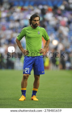MADRID, SPAIN - May 13th, 2015 :  Italian player ANDREA PIRLO of JUVENTUS TORINO warms up during Europe Champions League match VS REAL MADRID at Santiago Bernabeu Stadium - stock photo