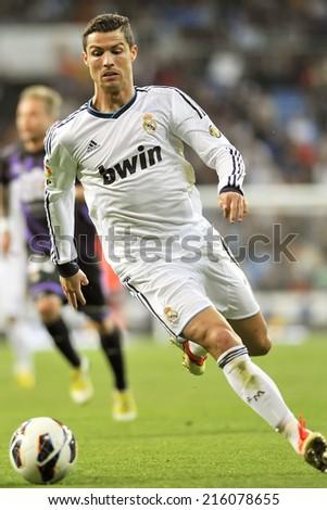MADRID, SPAIN - May 4th, 2013 :  Portuguese football superstar of Real Madrid CRISTIANO RONALDO in action during La Liga match at Santiago Bernabeu Stadium.  - stock photo
