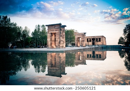 Madrid, Spain - May 10, 2014 The Temple of Debod (Templo de Debod) an ancient Egyptian temple rebuilt in Madrid with visiting tourists at dawn, Spain. - stock photo