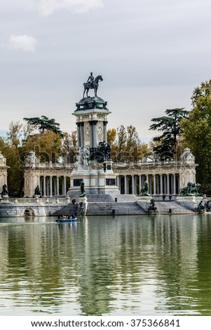 MADRID, SPAIN - NOVEMBER 20, 2013: Buen Retiro Park (Park of Pleasant Retreat) - one of largest parks in Madrid. Park belonged to Spanish Monarchy until late 19th century when it became a public park.