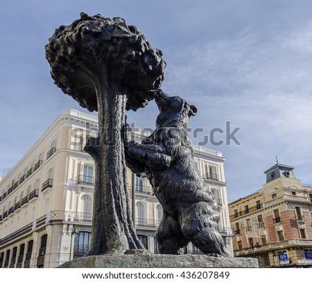 Madrid, Spain - November 27, 2015: Symbol of Madrid - the bear and the strawberry tree. Spain - stock photo