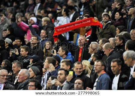 "MADRID,SPAIN - November 11th, 2014 : British fan of LIVERPOOL holding ""You will never walk alone""  motto legend scarf during the UEFA Champions League match vs REAL MADRID at Santiago Bernabeu  - stock photo"