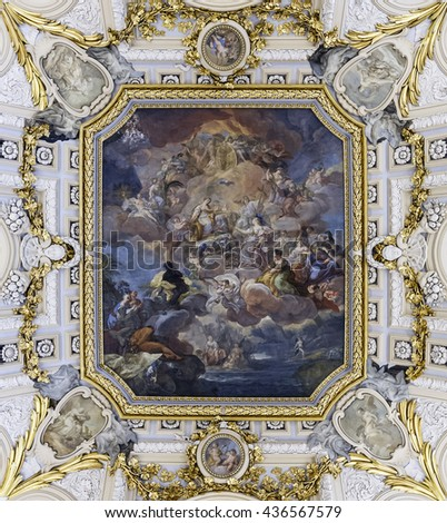 Madrid, Spain - November 27, 2015: The fresco Corrado Giaquinto (Spain Pays Homage to Religion and to the Church) on the vaulted ceiling in the Royal Palace of Madrid. It is popular tourist attraction