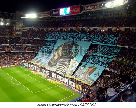 MADRID, SPAIN - NOVEMBER 7: The Real Madrid supporters at the Santiago Bernabeu Stadium for the Liga game against Atletico Madrid on November 7, 2010. Final score: 2-0 for the home team. - stock photo