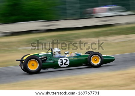 MADRID, SPAIN - OCT 30 : A driver races in a classic Jim Clark's Lotus 32B during the Jarama Vintage Festival, on Oct 30, 2011 in Madrid, Spain. - stock photo