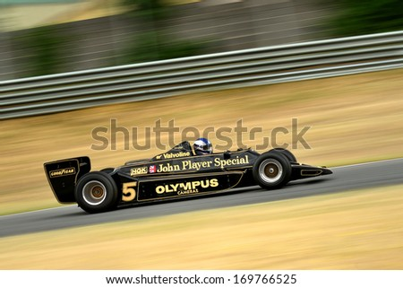 MADRID, SPAIN - OCT 30 : A driver races in a classic Mario Andretti Lotus 79 during the Jarama Vintage Festival, on Oct 30, 2011 in Madrid, Spain. - stock photo