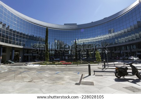 MADRID, SPAIN OCT 15: Modern building with glass architecture on October 15 2012, In one of the most modern financial areas of Madrid, recently premiered this modern complex of offices for rent. - stock photo