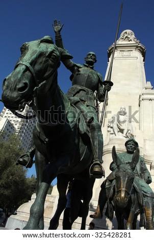 MADRID, SPAIN - OCTOBER 20, 2014: A photograph of Miguel de Cervantes Saavedra monument at Plaza de España in Madrid, Spain, October 20, 2014. - stock photo