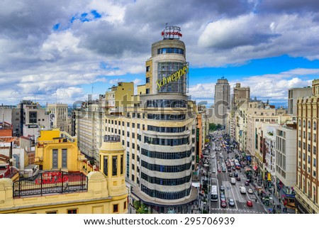 MADRID, SPAIN - OCTOBER 15, 2014: Gran Via at the Iconic Schweppes sign. The street is the main shopping district of Madrid. - stock photo