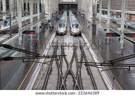 MADRID, SPAIN - OCTOBER 9, 2014: High speed trains in Atocha Station in Madrid. Spain's main cities are connected by high-speed trains. - stock photo