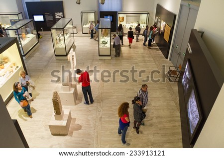MADRID, SPAIN - OCTOBER 18: People visiting National archeological museum in Madrid, Spain on October 18, 2014. - stock photo