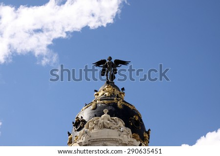 MADRID, SPAIN - OCTOBER 04, 2013: Sculpture of an angel on the roof of a historical building on the Gran Via in Madrid - stock photo