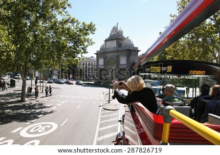 MADRID, SPAIN - OCTOBER 05, 2013: Woman photographed attractions from the sightseeing bus - stock photo