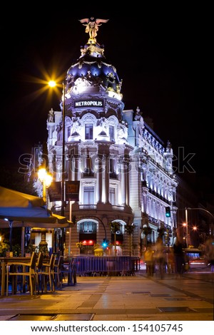 MADRID, SPAIN - 10 SEPTEMBER: Night scene in Metropolis Building and Gran Via Street one of the main landmarks of the city, inaugurated in 1911, on September 10, 2013 in Madrid, Spain