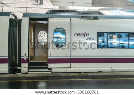 MADRID, SPAIN - SEPTEMBER 16, 2016: Spanish High speed train Renfe Ave at platforms in Atocha Station.