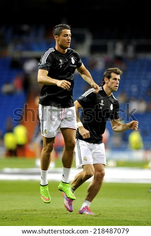MADRID, SPAIN - September 13th, 2014 : CRISTIANO RONALDO and GARETH BALE of Real Madrid warm up during the UEFA Champions League 2014 match at Santiago Bernabeu Stadium.  - stock photo