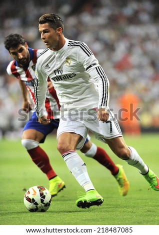 MADRID, SPAIN - September 13th, 2014 : Portuguese CRISTIANO RONALDO of Real Madrid and JUAN FRAN of Atletico de Madrid in action during La Liga match at Santiago Bernabeu Stadium.  - stock photo