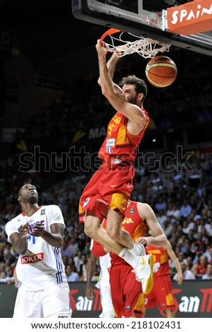 MADRID, SPAIN - September 10th 2014 : RUDY FERNANDEZ of Spain slam dunk during the 1/4 final game versus France of the FIBA BASKETBALL WORLD CUP 2014 at Palacio de los Deportes Arena - stock photo