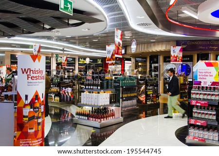 MADRIT, SPAIN - APRIL 20: Duty Free shop on April 20, 2013 in Madrid, Spain. Duty free shops are retail outlets that are exempt from the payment of certain local or national taxes and duties - stock photo