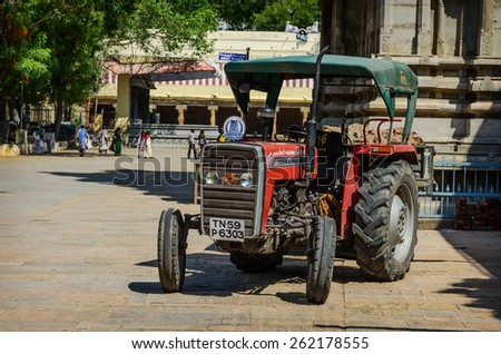 MADURAI, INDIA - FEBR 16: Wheeled tractor inside  Meenakshi Temple one of the most holy place for hindu people on Febr 16, 2013. India, Madurai, Tamil Nadu - stock photo