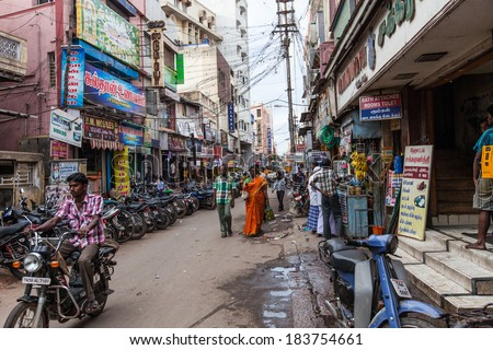 MADURAI, INDIA-FEBRUARY 15: Street of Indian city 15, 2013 in Madurai, India. People on the street of indian town - stock photo