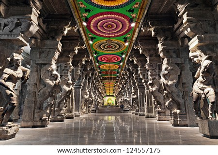 MADURAI, INDIA - MARCH 22: Meenakshi Temple - one of the biggest and oldest temple on March 22, 2012 in Madurai, India. Its about 2500 years old. The 14 gateway towers ranging from 45 to 50m. - stock photo